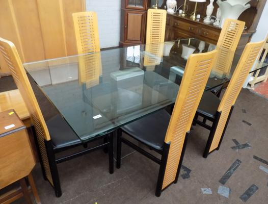 Modern glass topped table with 6 chairs