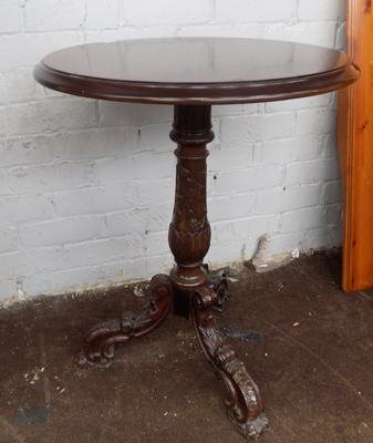 Round carved tripod table