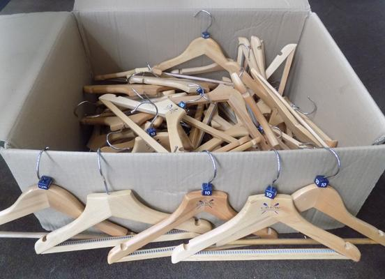 Box of kid's wooden coat hangers