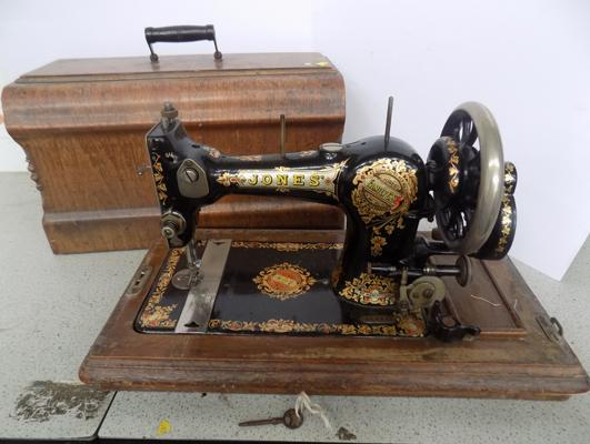 Jones sewing machine in wooden case