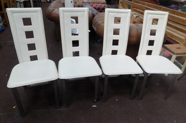Set of four cream dining chairs