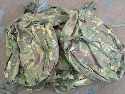 Four used camoflage bergens