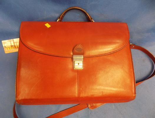 Leather briefcase with shoulder strap in good condition