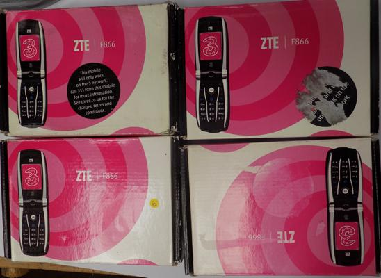 Four boxed mobile phones