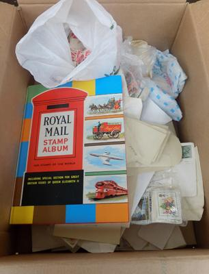 Box of stamps inc Royal Mail stamp album