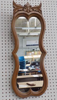 Walnut framed unusual mirror