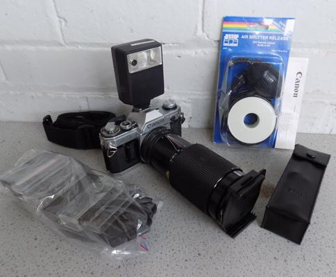 Canon AE1 camera + zoom 70-210 lens/speedlite/filters/strap/release