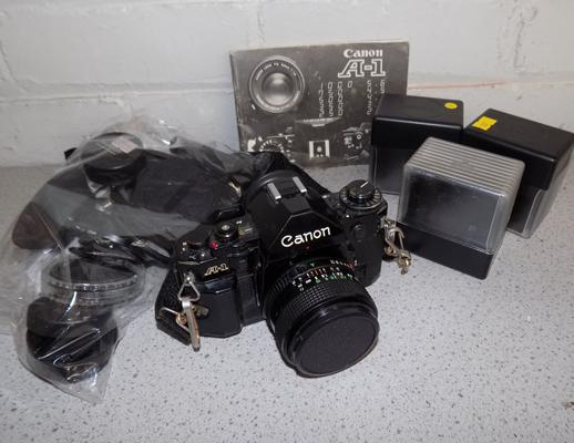 Canon A1 camera + 28mm lens filter/papers/bits
