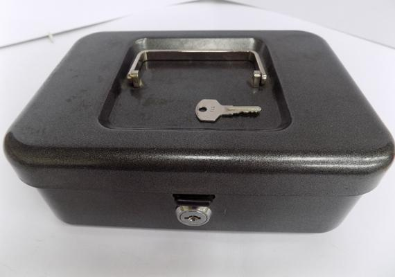 Cash box with key, key in office