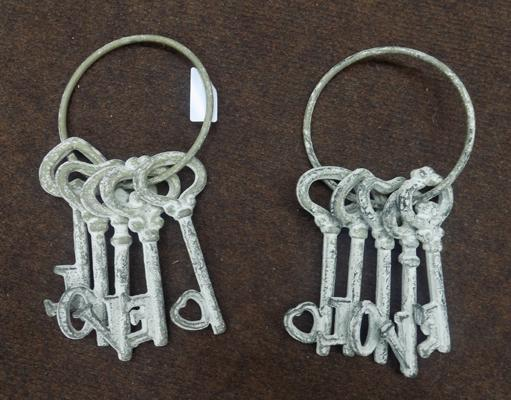Two sets of cast iron display keys