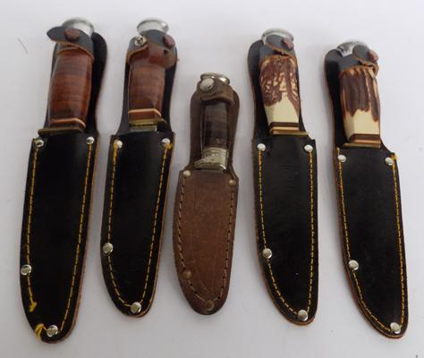 Selection of knives in sheaths