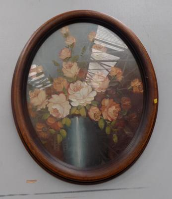 Oil painting in oval frame