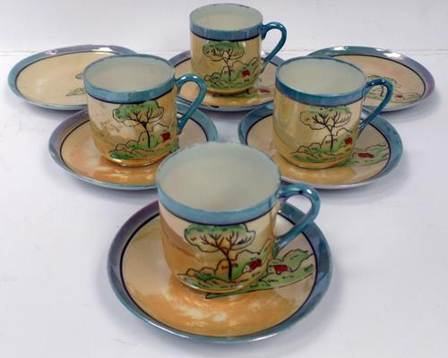 4 Japanese coffee cups and 6 saucers - small chip on one plate