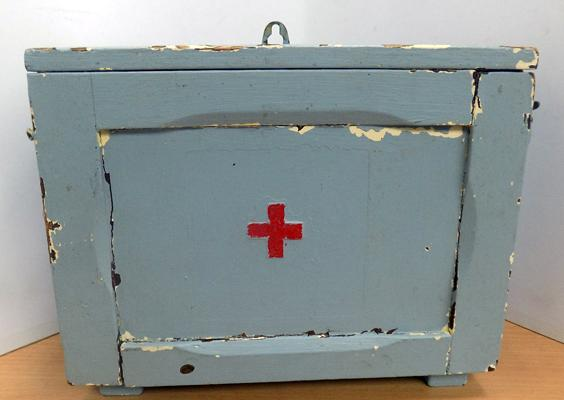 Vintage first aid box with contents