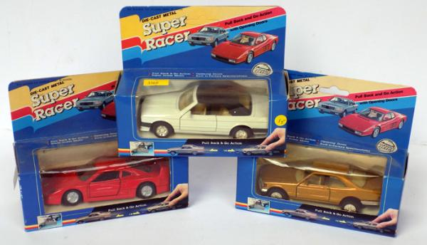 3 boxed collectable diecast cars