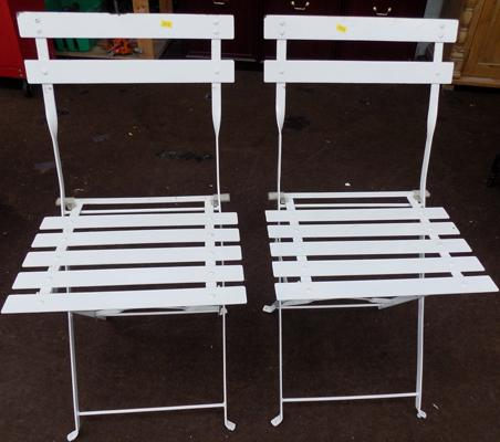 Two white bistro chairs