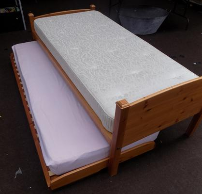 Single bed with legged guest bed