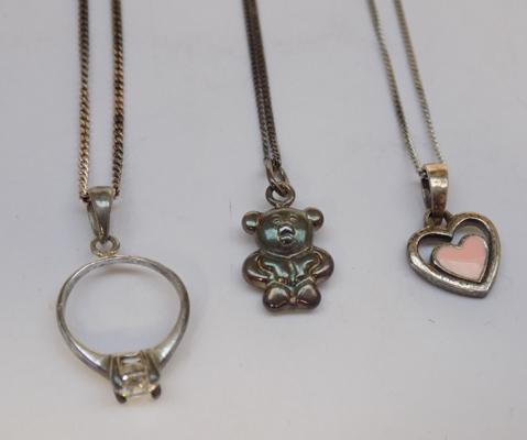 Three sterling silver necklaces & pendants, incl. enamel & teddy bear