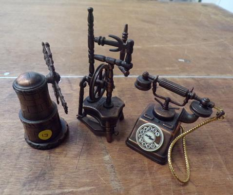Three vintage copper novelty desktop pencil sharpeners