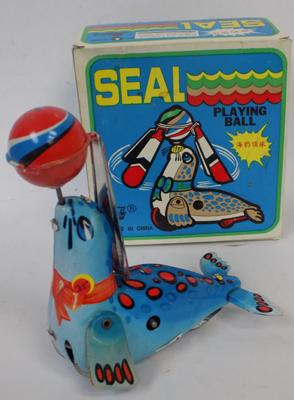 Vintage tinplate clockwork 'seal playing with ball' with key