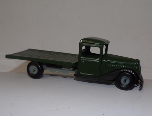 Vintage clockwork tinplate 1950 Austin flat truck, 7 inches long