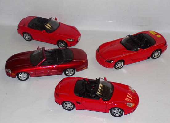 Four precision diecast sports cars, mint condition, 1/24 scale