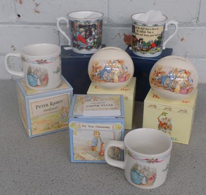 Two Royal Doulton Bunnykins money boxes, 2 Wedgwood Peter rabbit mugs, 2 Royal Worcester mugs