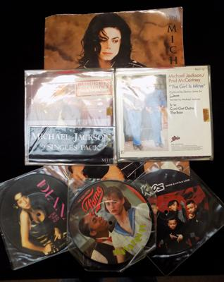 Selection of Michael Jackson singles, 1 limited edition on pressed red vinyl & other items + three picture disc singles
