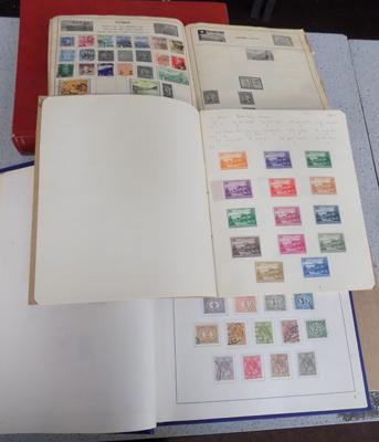Four albums of World stamps with earlier issue