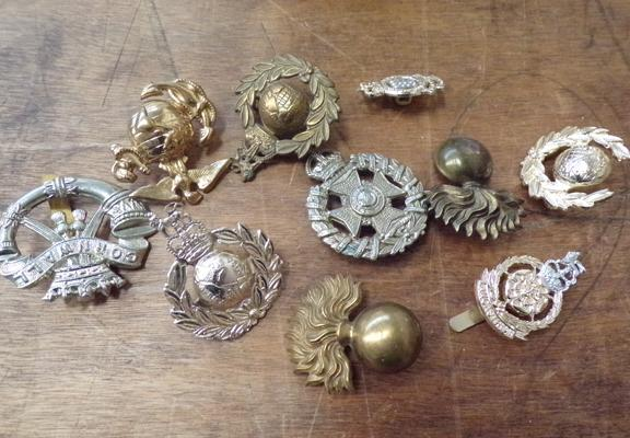 Ten vintage military cap badges