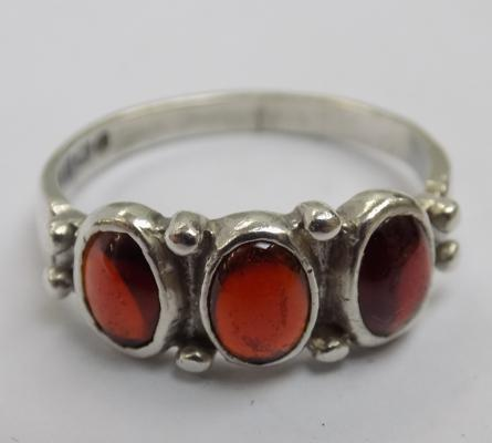 Vintage sterling silver and garnet gemstone trilogy ring, Birmingham circa 1978, makers Ammonite Ltd.