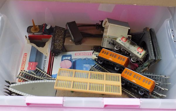 Box of tracks, controllers, trucks, transformer, platform, signal box, long track