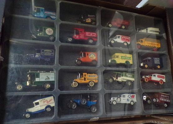 Collection of vintage diecast advertising vans in display case