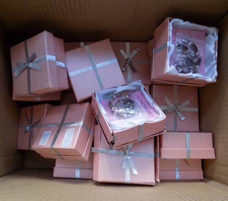 Box of costume jewellery in presentation boxes