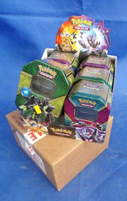 Two boxes of Pokemon tins (tins empty)