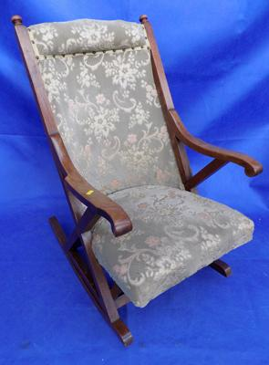 Vintage upholstered armed rocking chair