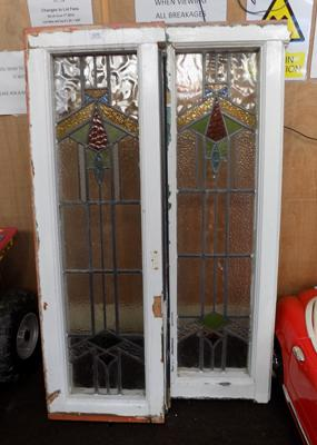Two framed stain glass leaded windows