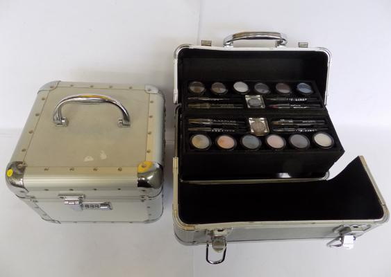Two metal make-up boxes, flight case style - lock code 777
