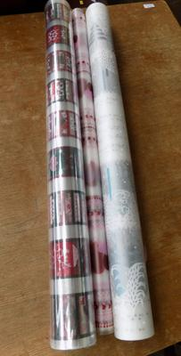 Three rolls of cellophane, one unopened