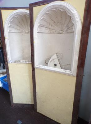 Two alcoves in wooden frames