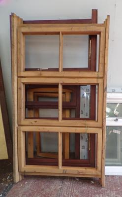 Selection of wooden unglazed window frames & one UPVC frame with glass