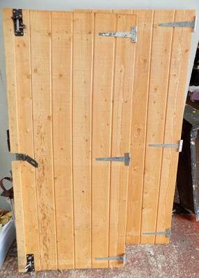 Two new wooden shed doors, size 27 x 62 inches