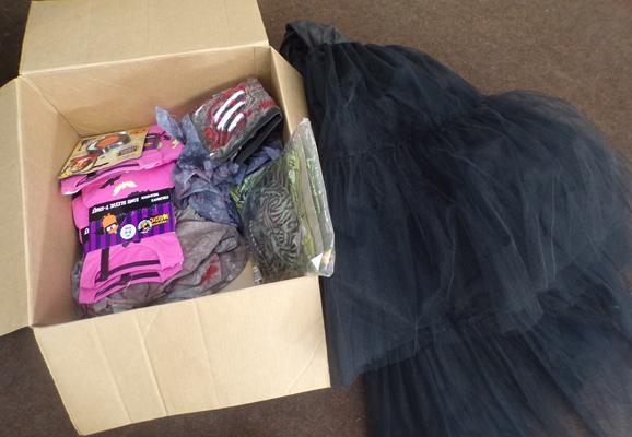 Box of Halloween costumes + masks