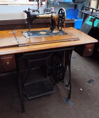 Vintage Jones sewing machine on treadle stand