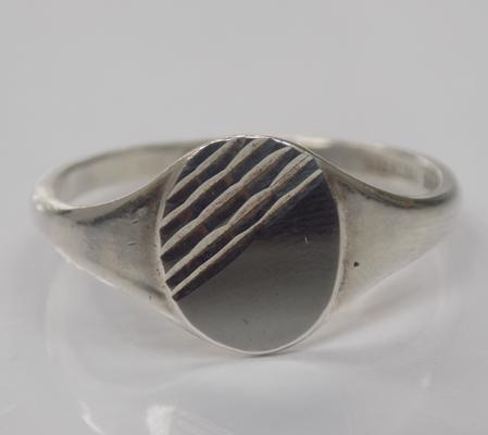A sterling silver signet ring; approximate size Y -  marked 'sterling silver'