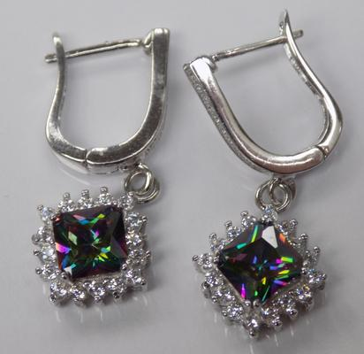 A pair of silver, mystic topaz set earrings