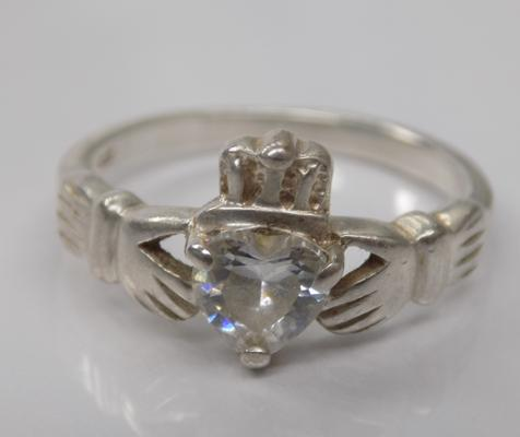 A silver and CZ set Claddagh ring