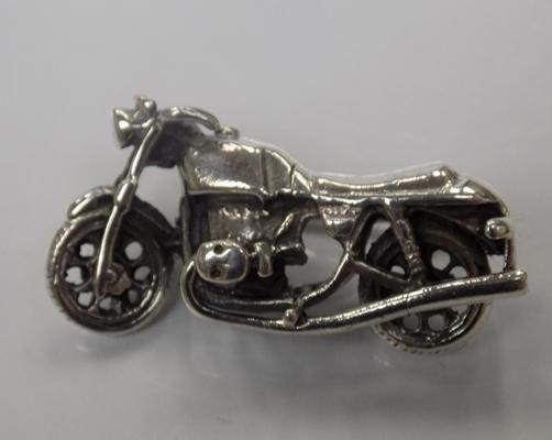 A silver motorbike badge