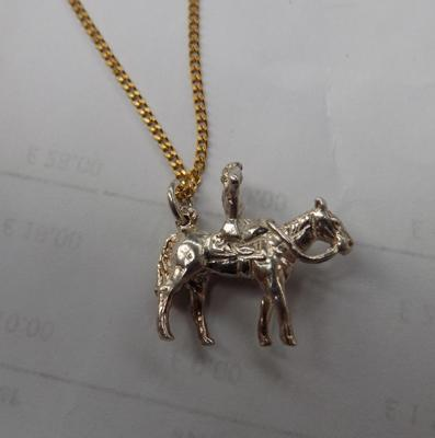 A fine detailed, solid silver horse/equestrian themed pendant on chain