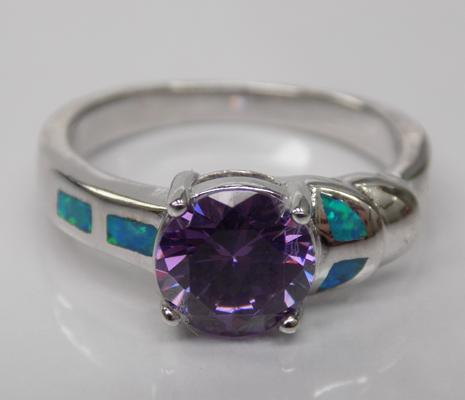 A silver opal and amethyst set ring
